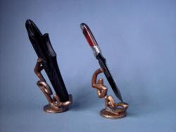 """Tharsis Intense"" left side view showing sculpted solid bronze forms complimenting knife and sheath"