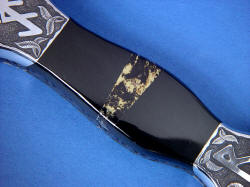 """Vesta"" black rune dagger, obverse side view, handle detail. Black Australian Jade is very hard and tough, flanking mosaic of black shale with pyrite (Apache gold) gemstone"