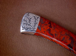 """Wasat"" reverse side rear bolster engraving detail. Lines of stromatolite gemstone echoed in the curves of the light vine pattern of sthe engraving"