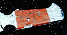 Brecciated Jasper on full tang knife with mechanism. Jasper is tough enough to support machine screw mounting!