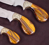 Tiger eye quartz makes striking, beautiful full tang knife handles like this set, on palm shaped handles