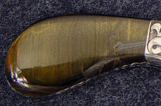 Blue tiger eye quartz on this full tang knife polishes brightly and is durable and tough