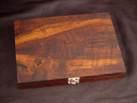 The Trophy Game Set hardwood case in Imbuya exotic wood and brass