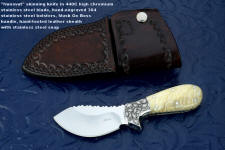 """Nunavut"" custom skinning knife, obverse side view in 440C high chromium stainless steel blade, hand-engraved 304 stainless steel bolsters, Musk Ox boss horn handle, hand-tooled leather sheath"
