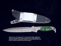 "US Army Special Forces ""Treatymaker LT"" combat knife with locking sheath. Note large die formed high strength aluminum belt loop plate for sheath mounting on tactical gear"