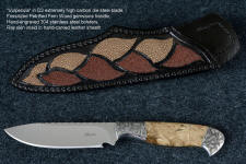 """Vulpecula"" obverse side view in D2 extremely high carbon die steel blade, hand-engraved 304 stainless steel bolsters, Petrified Fern fossil gemstone handle, hand-carved leather sheath inlaid with rayskin"